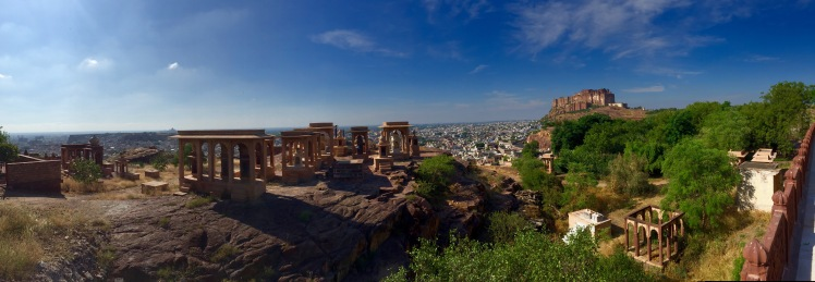 View of the Mehrangarh Fort on the right and tombs at the nearby royal crematorium