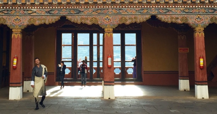 The gho worn with a shawl that many guides put on when entering a dzong as a sign of respect