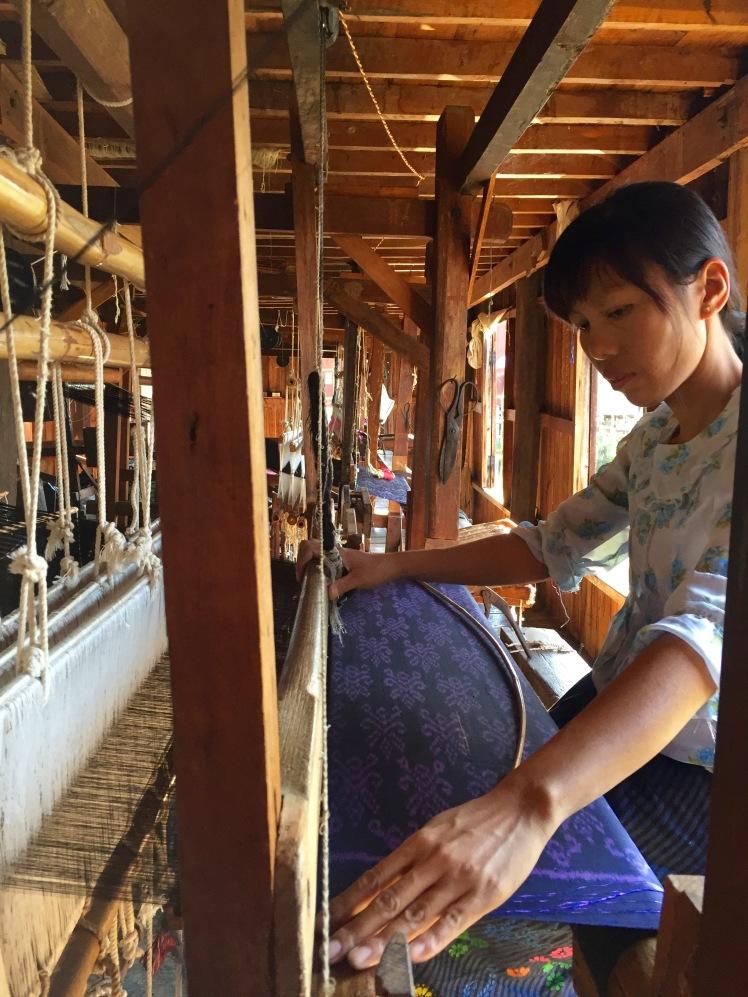 Woman weaving a shawl