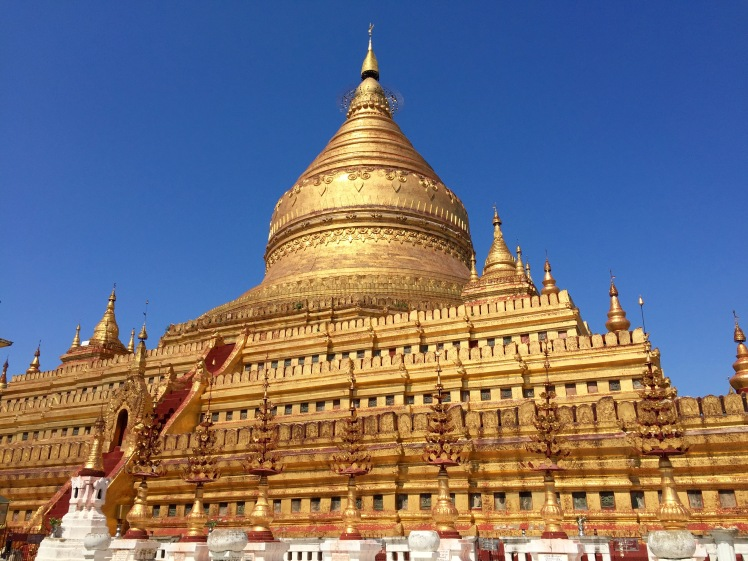 Shwezigon Pagoda. They just can't help themselves with the gold.