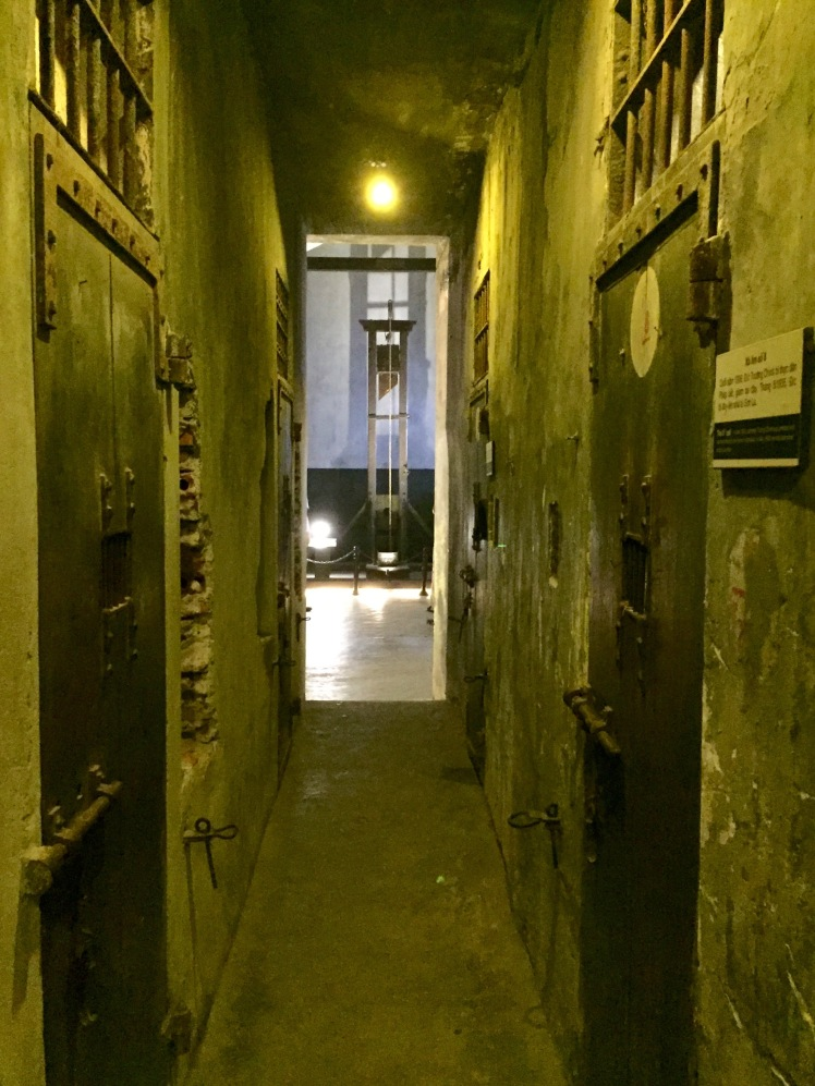 Corridor with cells where the French kept prisoners before their executions. Note the guillotine at the end of the hall