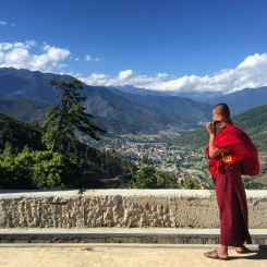 Buddhist monk on his iPhone at Buddha Dordenma, Thimphu