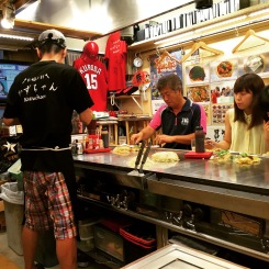 Chef prepares a local speciality in Hiroshima, okonomiyaki